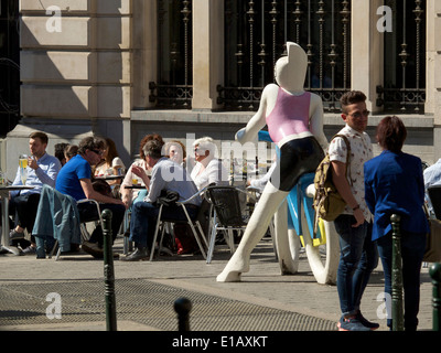 People sitting outside and drinking a beer in the sun, Brussels city center, Belgium - Stock Photo