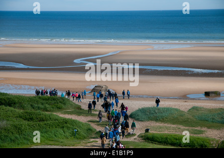 People visiting Omaha Beach, one of the landing beaches of the Normandy invasion, Colleville-sur-Mer, Normandy - Stock Photo