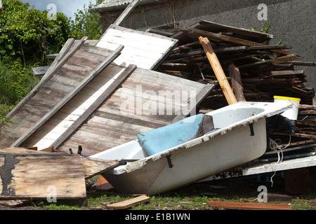 Timber an old bath all Builders Rubbish in a Yard in Cornwall - Stock Photo