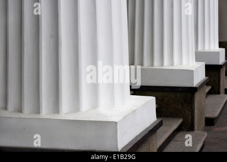 Three classical white greek columns in a row - Stock Photo