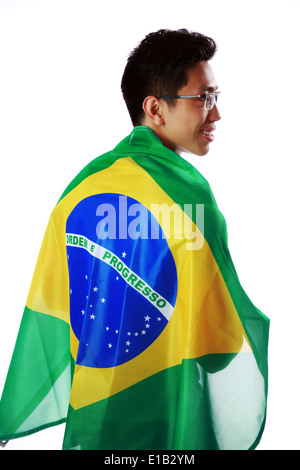 Back view portrait of a man holding Brazilian flag over white background - Stock Photo