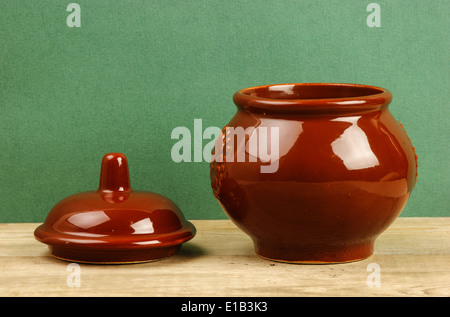clay pot on an old wooden table - Stock Photo