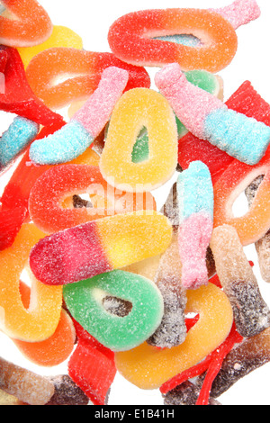 Kids gummy candies or sweeties in multi colors and a variety of shapes. - Stock Photo