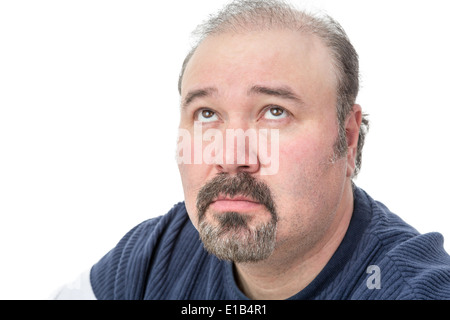 Close-up portrait of a mature man thinking in a serious expression - Stock Photo