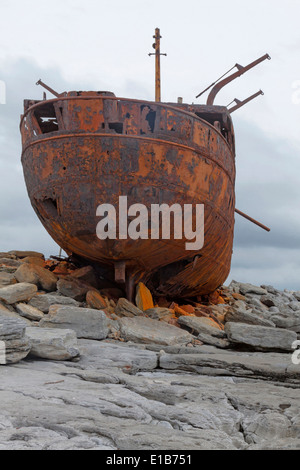 The rusty shipwreck of MV Plassey  on Finnis Rock, Inis Oirr or Inisheer, one of the three Aran Islands, West Ireland.