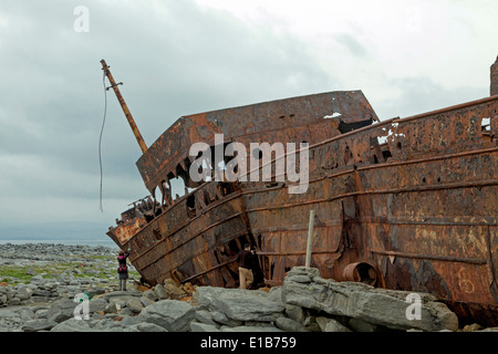 The rusty shipwreck of MV Plassey  on Finnis Rock, Inis Oirr or Inisheer, one of the three Aran Islands, Republic of Ireland.