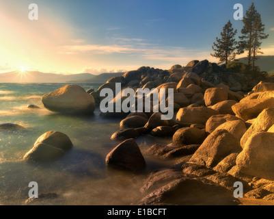 Sunset and rocks on Lake Tahoe. Sand Harbor State Park, Nevada - Stock Photo