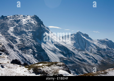 Early Autumn snow and mountain panorama  including The Weissfluh from above Parsenn Davos Graubunden Switzerland - Stock Photo