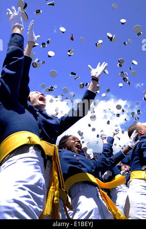 Cadets at the US Air Force Academy Class of 2014 celebrate by throwing their hats into the air at the conclusion - Stock Photo