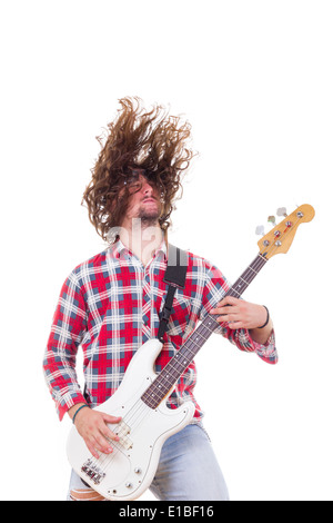 adult man in red shirt with tousled hair playing electric bass guitar - Stock Photo