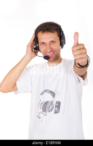 assistant with headset showing ok with thumb up gesture - Stock Photo