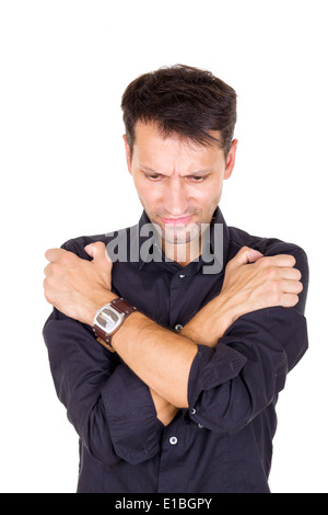 worried stressed out man in pain having problems with hands crossed - Stock Photo