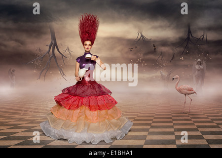 Alice in wonderland wearing prom dress and brewing tea - Stock Photo