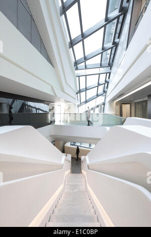 Jockey Club Innovation Tower, Hong Kong, China. Architect: Zaha Hadid Architects, 2014. Vertical view of atrium, - Stock Photo