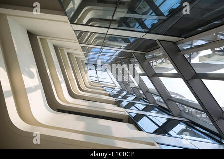 Jockey Club Innovation Tower, Hong Kong, China. Architect: Zaha Hadid Architects, 2014. View of atrium looking up. - Stock Photo