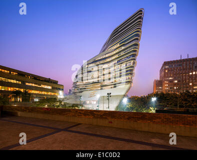 Jockey Club Innovation Tower, Hong Kong, China. Architect: Zaha Hadid Architects, 2014. View of east facade Hong - Stock Photo