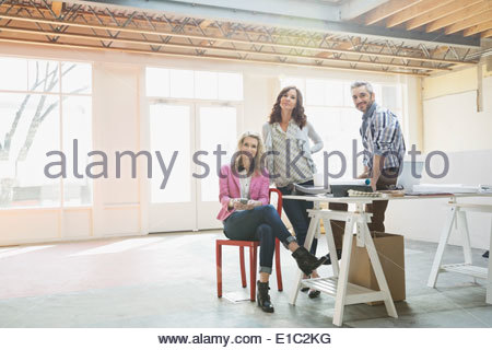 Portrait of confident business people in new office - Stock Photo