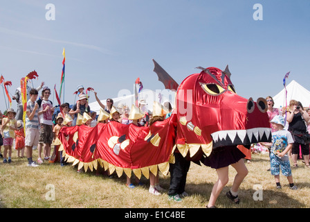 Tewkesbury Medieval Festival, Gloucester UK July 2013: alchemy entertain children with giant puppet dragon at the - Stock Photo