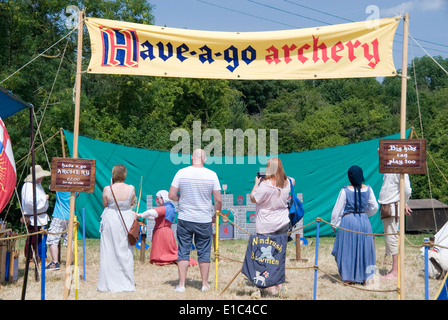 Tewkesbury Medieval Festival, Gloucester UK July 2013: Have-a-go Archery stall and contestants - Stock Photo