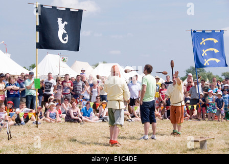 Tewkesbury Medieval Festival, Gloucester UK July 2013: jugglers juggling with a hapless victim from the crowd between - Stock Photo