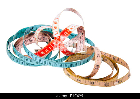 three tape measures marked in inches and centimeters - Stock Photo