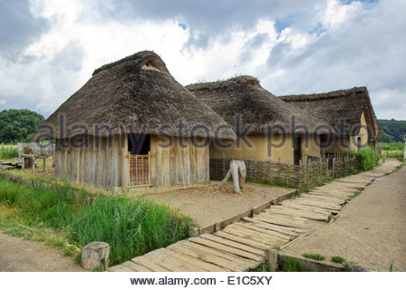 In its heyday, the Viking market town of Haithabu had about 1000 such thatch-roofed houses surrounded by a semicircular - Stock Photo