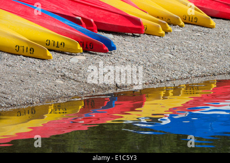 Kayaks for hire, laid out on the shores of Colter Bay at Jackson lake in the Grand Teton National Park. - Stock Photo