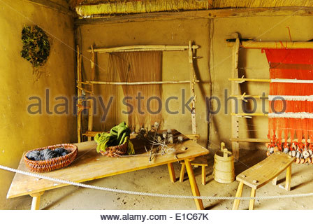 The implements and furnishings in the weaver's hut in the reconstructed Viking market town of Haithabu are based - Stock Photo
