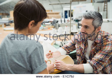 Workers in textile manufacturing plant - Stock Photo