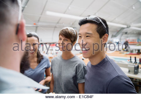 Workers meeting in textile manufacturing plant - Stock Photo