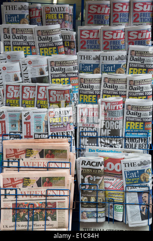 Stand of tabloid newspapers at a newsagents. London, UK. The Sun, the Daily Mail, The Star, Daily Mirror predominantly. - Stock Photo