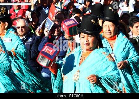 La Paz, Bolivia. 30th May 2014.  Morenada dancers wave rattles in the form of a cable car cabin while performing - Stock Photo