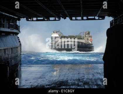 A landing craft, air cushion prepares to enter the well deck of the amphibious assault ship USS Bonhomme Richard - Stock Photo
