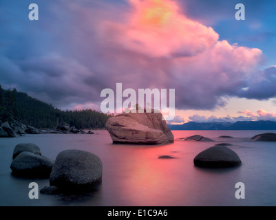 Sunset clouds and granite boulders on east side of Lake Tahoe, Nevada - Stock Photo