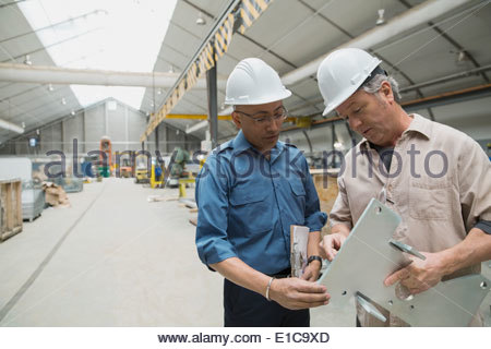 Workers meeting in manufacturing plant - Stock Photo