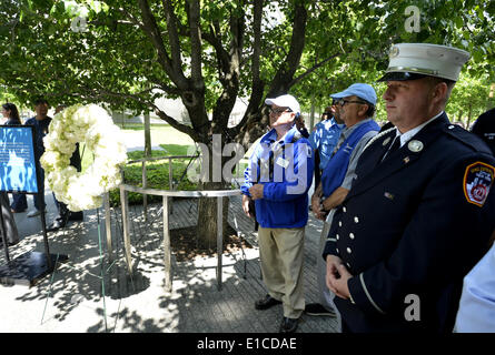 New York, USA. 30th May, 2014. A firefighter attends the wreath laying ceremony at the Ground Zero in New York, - Stock Photo