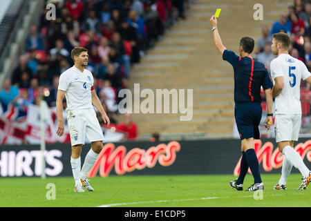 Wembley, UK. 30th May, 2014. England's Steven GERRARD (c) gets booked by referee Viktor KASSAI (Hungary) during - Stock Photo