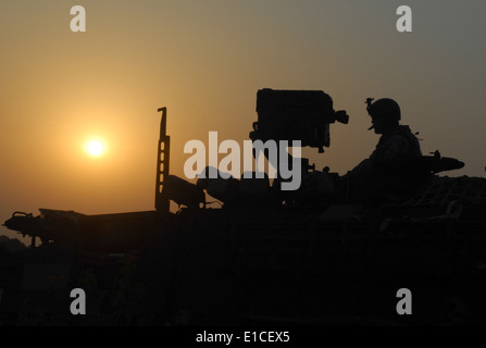 U.S. Army Sgt. Zachary Sherman provides overnight watch from a Stryker armored vehicle during Yudh Abyas 2009 on - Stock Photo