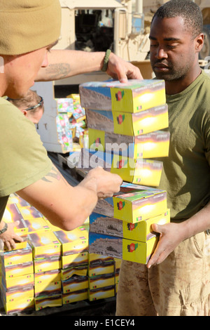 U.S. Marines with Headquarters and Service Company, 1st Battalion, 5th Marine Regiment unload boxes of radios at - Stock Photo