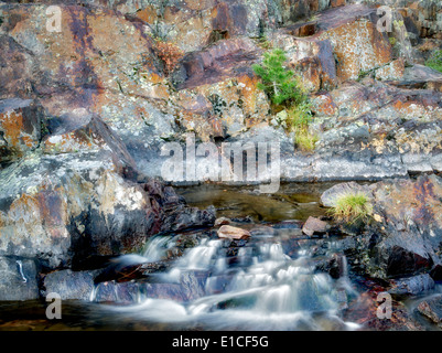 Small waterfal with lichen covered rocks on Glen Alpine Creek near Fallen Leaf Lake. California - Stock Photo