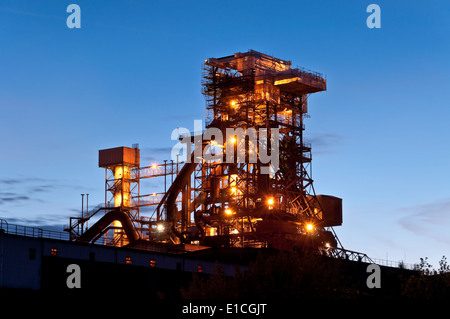 Lighted blast furnace at night in Germany  industrial plant blast furnace