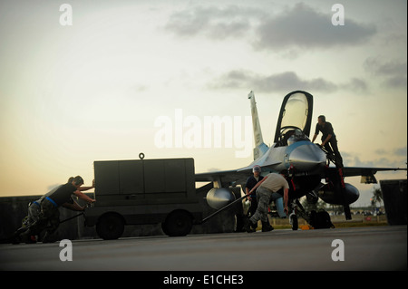 U.S. Air Force crew chiefs assigned to the 354th Aircraft Maintenance Squadron out of Eielson Air Force Base, Alaska, - Stock Photo