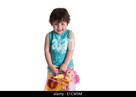 Portrait of a three year old girl with room for text on white background - Stock Photo