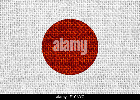 flag of Japan or Japanese banner on linen background - Stock Photo
