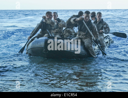 U.S. Marines assigned to the 31st Marine Expeditionary Unit launch a combat rubber raiding craft (CRRC) from the - Stock Photo