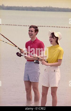 First daughter Julie Nixon Eisenhower with her husband, David, the grandson of President Dwight Eisenhower, fishing - Stock Photo