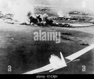 Photograph taken by a Japanese pilot, of the destruction of Pearl Harbor. At lower right is a Japanese bomber. Dec. - Stock Photo