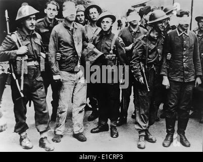 German POWs captured in the Dieppe Raid of August 19, 1942. Allied soldiers stand guard over blindfolded German - Stock Photo