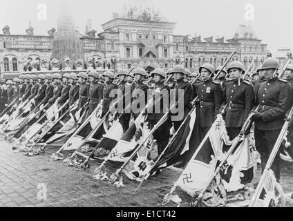 Russian victory parade in Moscow at the end of World War 2, June 24, 1945. Soviet soldiers holding Nazi standards - Stock Photo