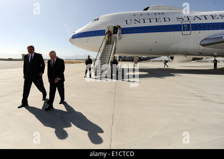Secretary of Defense Robert M. Gates is greeted by U.S. Ambassador to Afghanistan Karl Eikenberry upon his arrival - Stock Photo